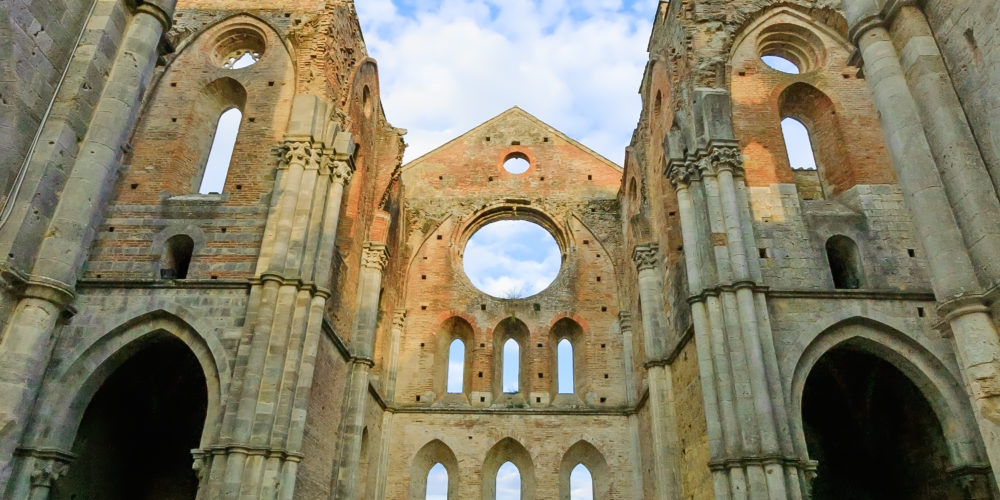 Saint or San Galgano medieval uncovered Abbey Church ruins. Tuscany, Italy